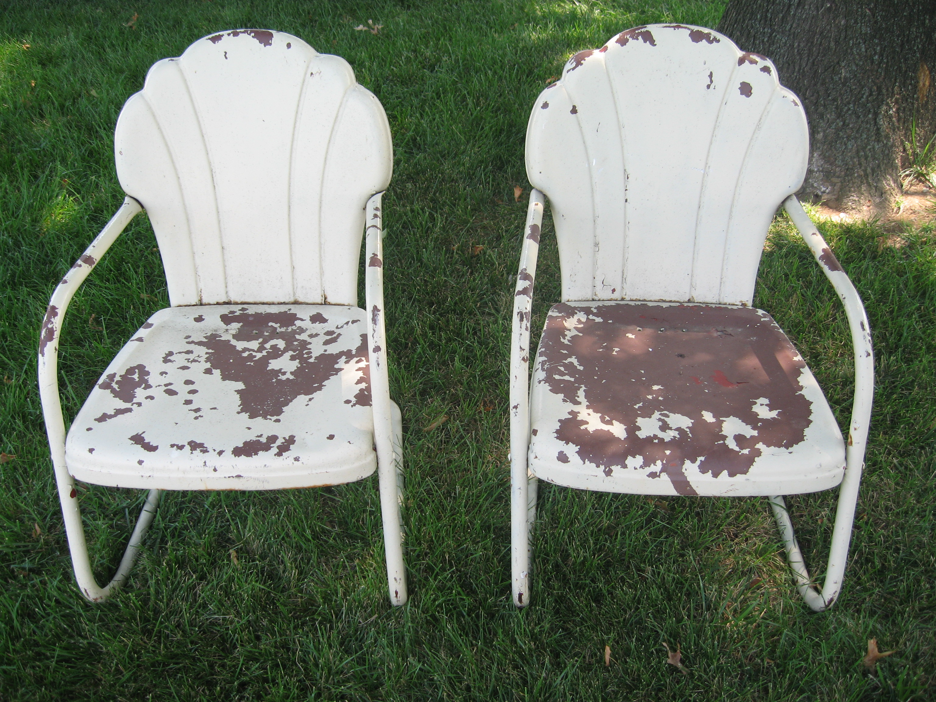 two metal lawn chairs