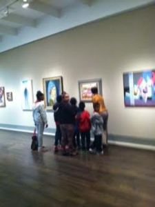 A museum docent shares her joy in art with Houston third graders and their chaperones
